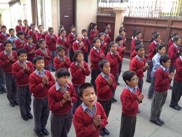 The students reciting prayers at morning assembly