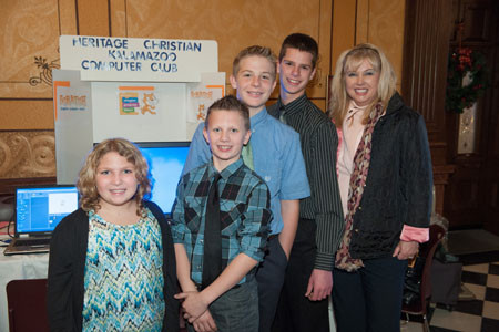 Members of the Heritage After-school Computer Club at the capital building in Lansing with State Senator Tonya Schuitemaker.