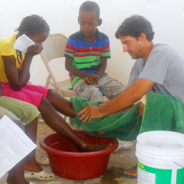 Kevin washing the children's feet.