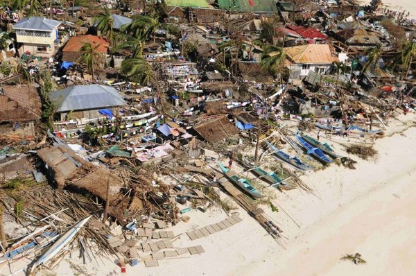 An aerial view shows damaged houses on a coastal community after Typhoon Haiyan hit Iloilo province in the central Philippines.  (Raul Banias for Reuters)