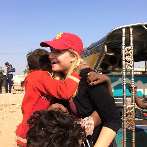 Katherine being greeted by some of the children she worked with in India