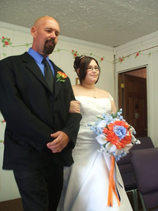 Ronnie walking Daughter Keysha down Aisle on her wedding day