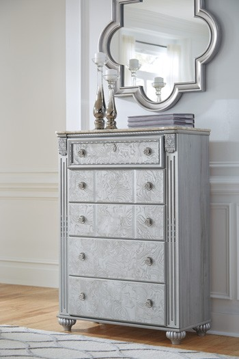 Zolena silver five drawer chest chests pruitt 39 s for Pruitts bedroom sets