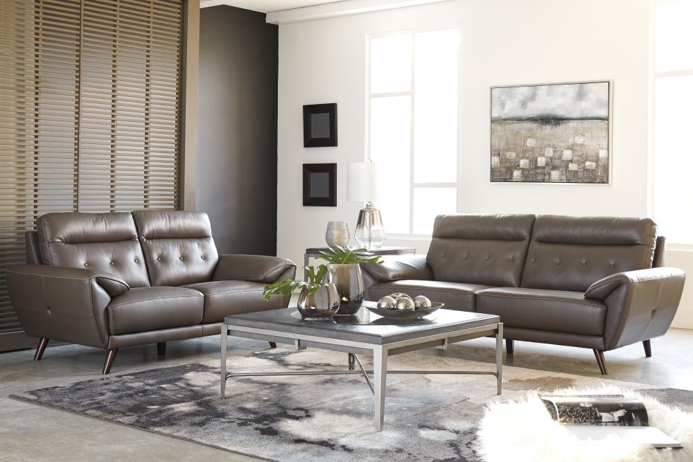 Sissoko gray sofa loveseat 34603 38 35 leather living room groups price busters for Texas leather interiors prices