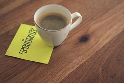 Medium 20150421132541 think small win customer loyalty post it note coffee cup mug wood desk office business