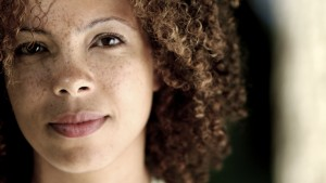 Mixed race woman with pensive expression