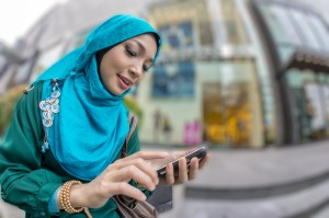 Young muslim women on cell phone