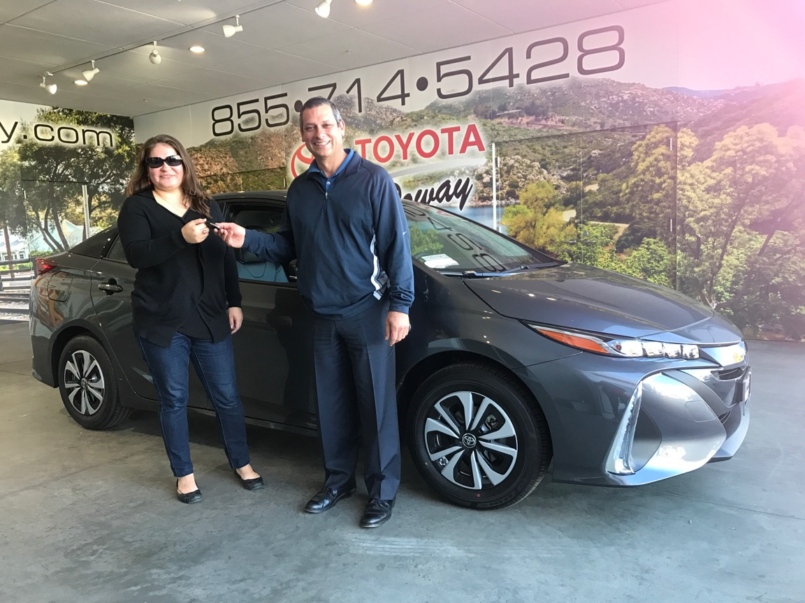 Vincent castro toyota of poway s owner and parishioner of st michael s catholic church in poway presents the keys to ms angie sagrero the winner of a