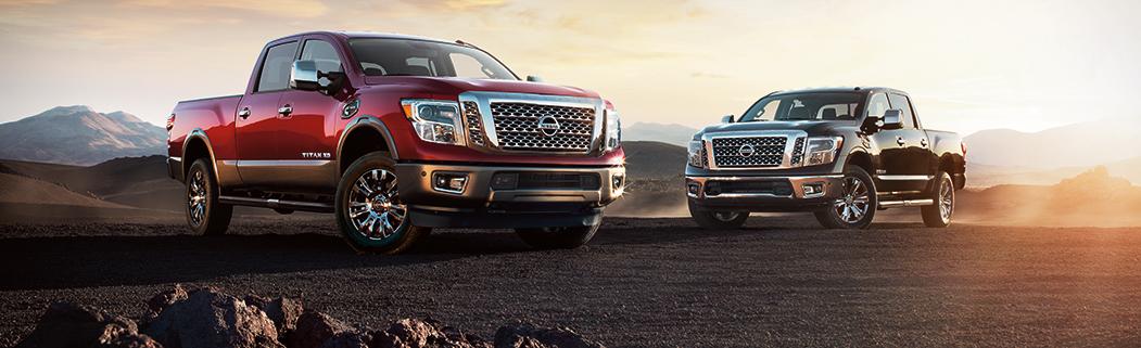 2017 Nissan Titan red and black pickup truck desert rocks Ganley Mayfield Dealership