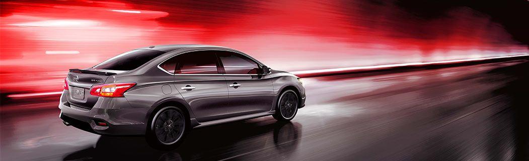 Vann York Nissan, silver Sentra driving through brightly lit tunnel