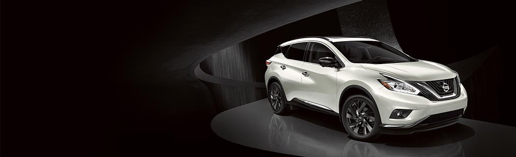 Vann York Nissan, White Murano in very modern, black room