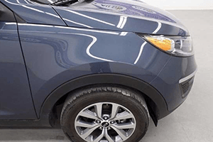 front right tire of 2016 blue kia sportage