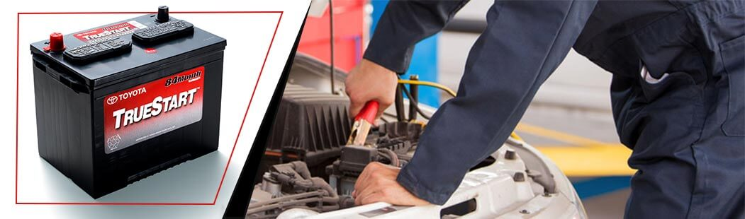 Ventura Toyota Battery Service, mechanic working on battery in engine