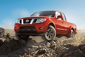 red 2016 nissan frontier dirt road