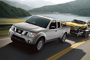 white 2016 nissan frontier trailer pulling old vehicle