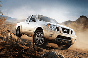 dirty white 2016 nissan frontier dirt