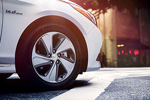 front right tire of white 2016 hyundai sonata hybrid