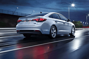 back of white 2016 hyundai sonata hybrid nighttime