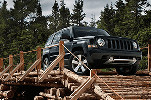 black 2017 jeep patriot wooden bridge