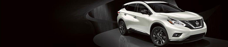 white Nissan Murano in black modern background