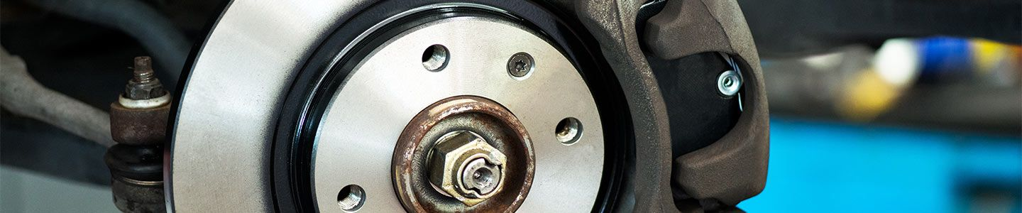 close up of brake service at All Star Kia East
