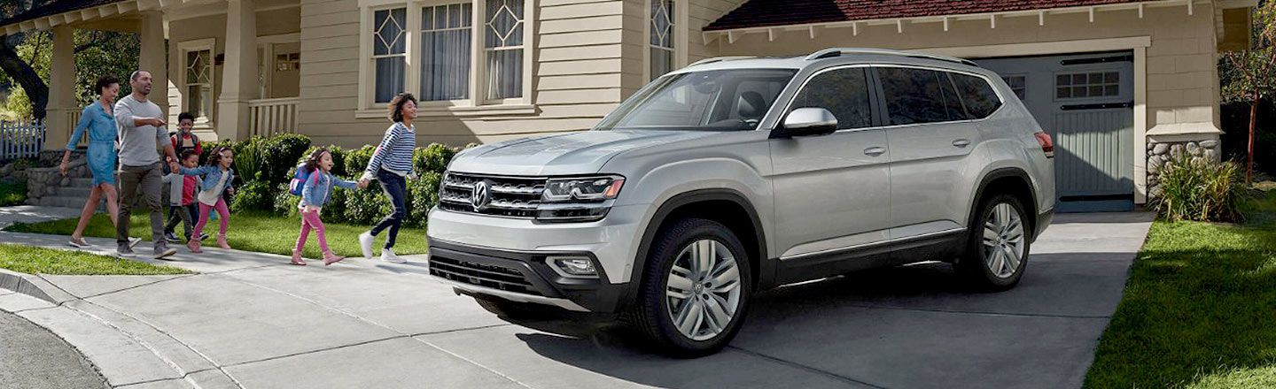 Ganley Bedford Imports, family and a silver 2018 Volkswagen Atlas