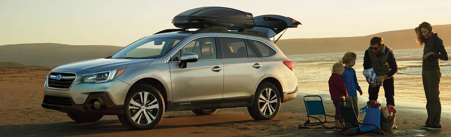 Ganley Bedford Imports, family at  beach next to 2018 Subaru Outback