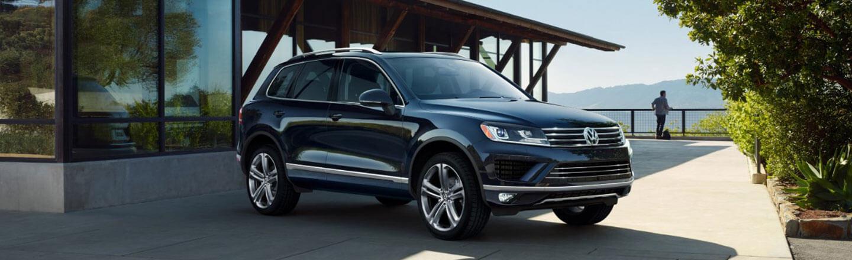 Ganley Bedford Imports, 2018 Volkswagen Touareg, outside modern home