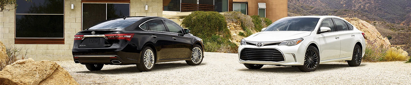 DCH Toyota of Oxnard, 2 2018 Avalon Hybrids, outside nice house in mountains