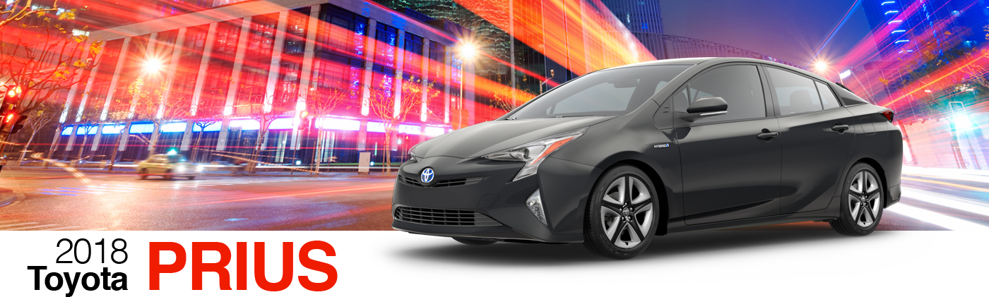 2018 Black Exterior Prius On Road at Fairfield Toyota