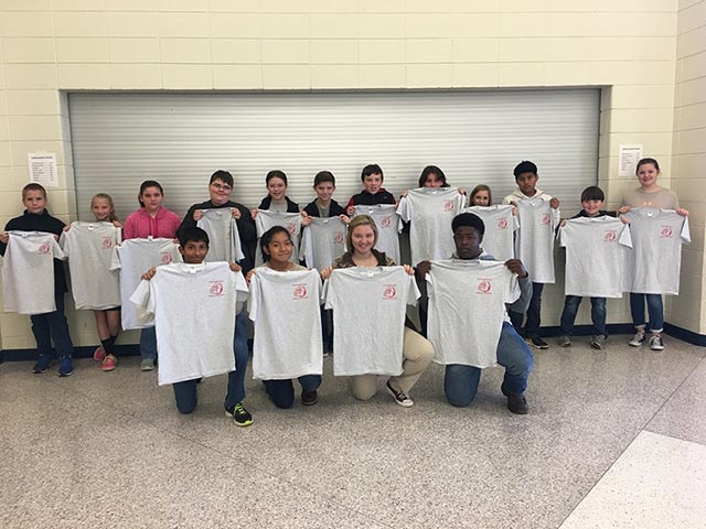Toombs County Middle School Students of the Month for October with donated t-shirts from Woody Folsom Nissan of Vidalia