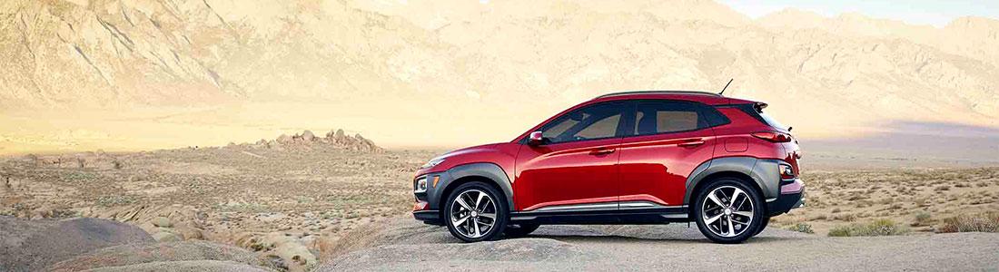 Profile of 2018 Hyundai Kona parked on desert rocks