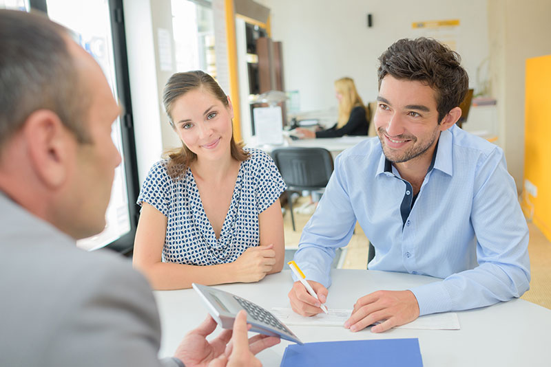 Young couple getting approved for a loan