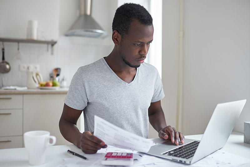 Young man applying for loan online