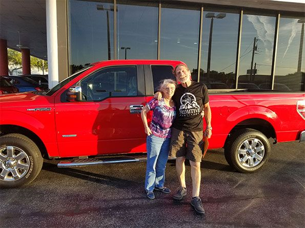 Happy couple in front of new Ford F-150