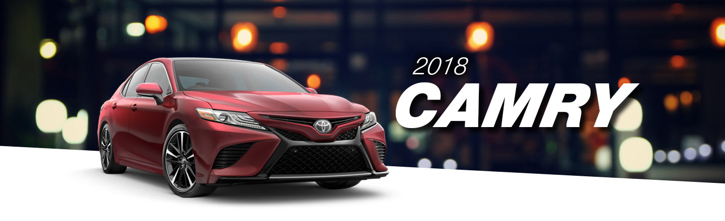 2018 Red Exterior Camry On Road at Ehrlich Toyota