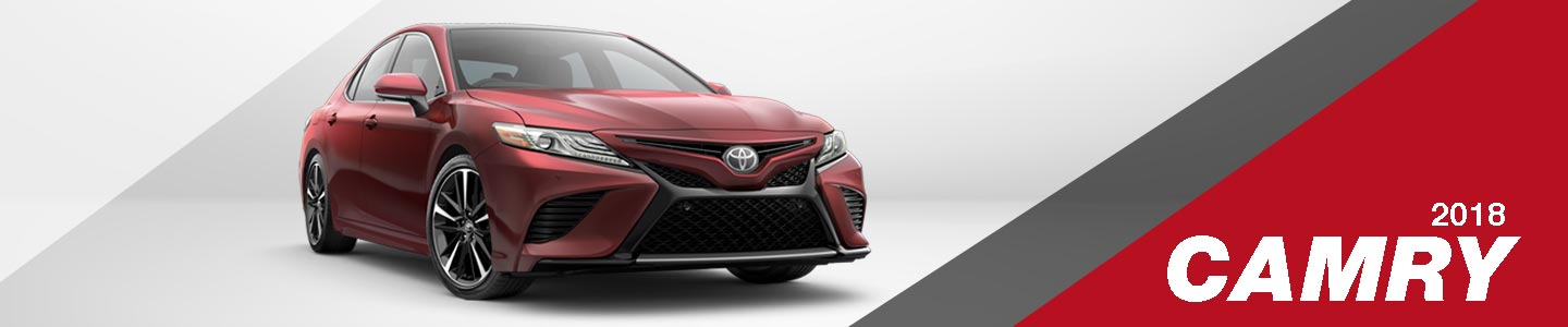 2018 Red Exterior Camry On Road at Jim Norton Toyota