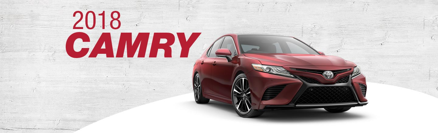 2018 Red Exterior Camry On Road at Henderson Toyota