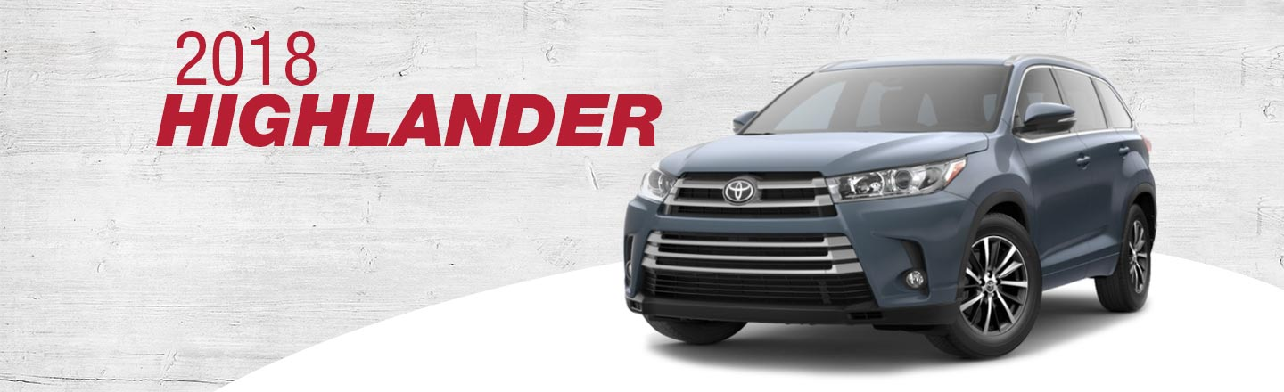 2018 Red Exterior Highlander On Road at Henderson Toyota