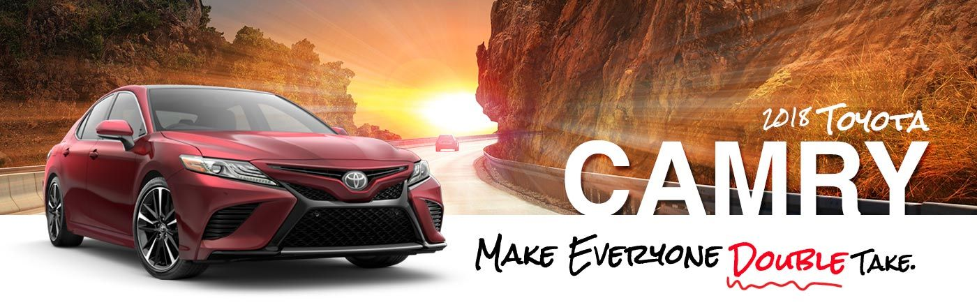 2018 Red Exterior Camry On Road at Desert Sun Toyota