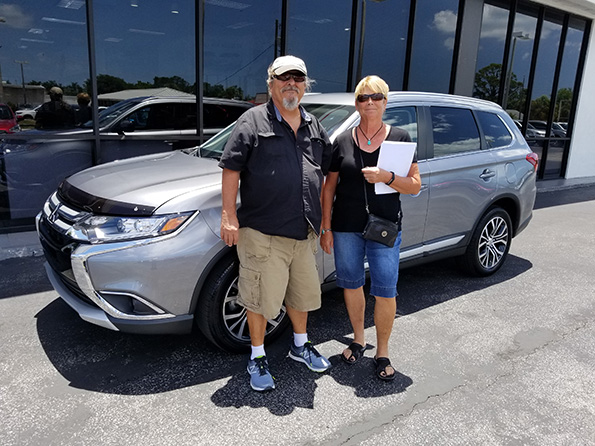 Happy couple just got a new car from Sarasota Mitsubishi