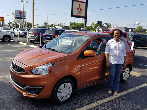 woman purchased orange mitsubishi from sarasota mitsubishi