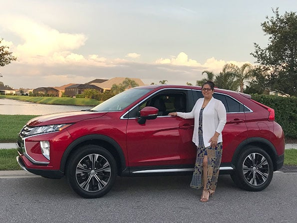 Maria happy customer red mitsubishi suv sunset clouds