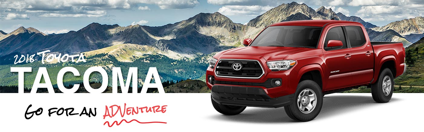 2018 Red Exterior Tacoma On Road at Ehrlich Toyota