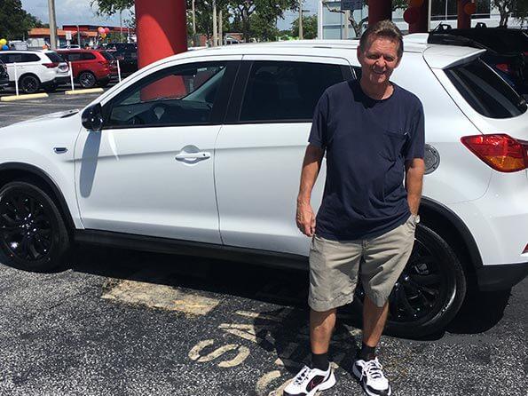 happy customer white mistubishi car