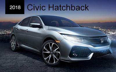 silver and blue 2017 civics hatchback on top of parking garage