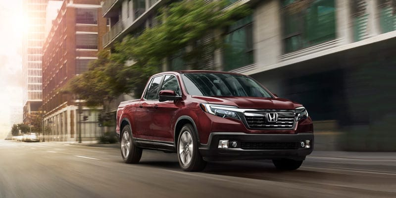 Red honda ridgeline front view