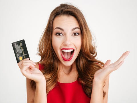 Female happy with credit card in hand