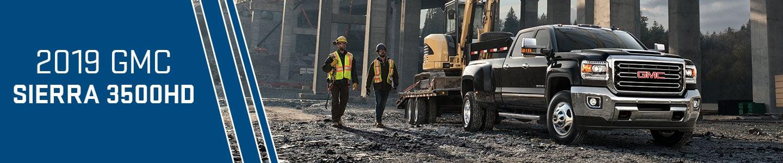 2019 gmc sierra 3500hd black truck construction site workers