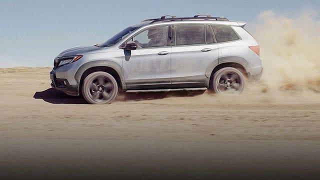 2019 Honda Passport driving in desert sand